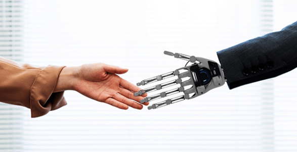 a human hand shaking hands with a robot hand